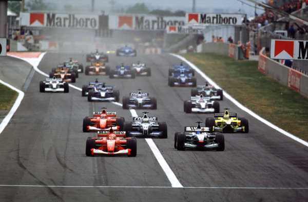 2001 Spanish Grand PrixCatalunya, Barcelona, Spain. 27-29 April 2001.Michael Schumacher (Ferrari F2001) leads from Mika Hakkinen (McLaren MP4/16 Mercedes), Ralf Schumacher (Williams FW23 BMW), Rubens Barrichello (Ferrari F2001) and Jarno Trulli (Jordan EJ11 Honda) at the start.World Copyright - LAT Photographicref: 35mm Image