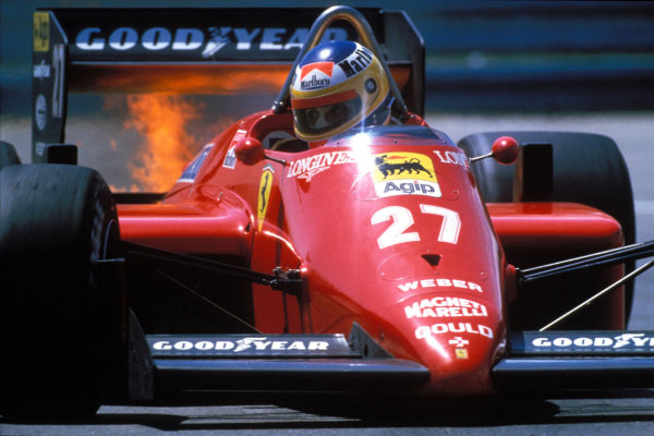Michele Alboreto, Ferrari 156/85, 1st position, with flames from his engine.