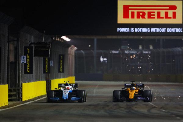 Carlos Sainz Jr., McLaren MCL34, battles with Robert Kubica, Williams FW42