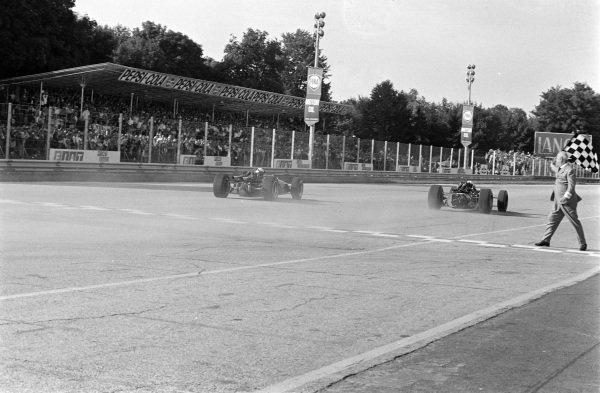 John Surtees, Honda RA300, takes victory by 0.2s from Jack Brabham, Brabham Repco BT24.