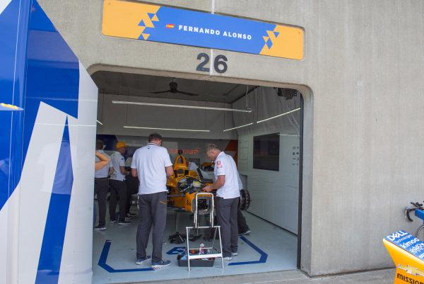 Fernando Alonso, McLaren Racing Chevrolet, crew prepare spare car after accident
