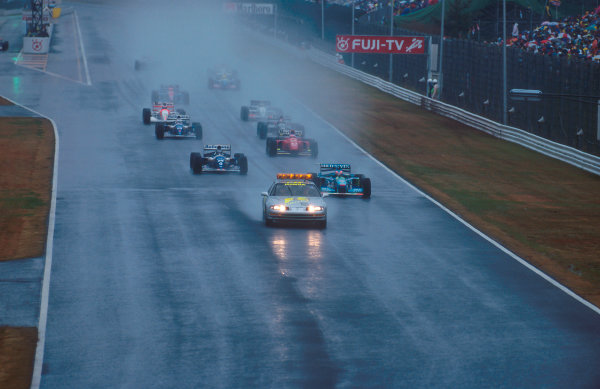 Suzuka, Japan. 4th - 6th November 1994.The safety car leads Michael Schumacher (Benetton B194 Ford), Damon Hill (Williams FW16B Renault), Jean Alesi (Ferrari 412T1B), Nigel Mansell (Williams FW16B Renault), Heinz-Harald Frentzen (Sauber C13 Mercedes) and Mika Hakkinen (McLaren MP4/9 Peugeot) before the race was restarted again.Ref-94 JAP 12.World Copyright - LAT Photographic