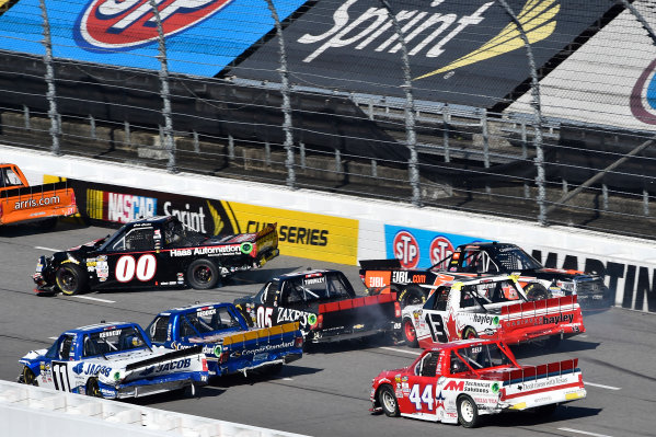 1-2 April, 2016, Martinsville, Virginia USA Cole Custer (00) and Christopher Bell (4) spin on the backstretch. ?2016, John Harrelson / LAT Photo USA