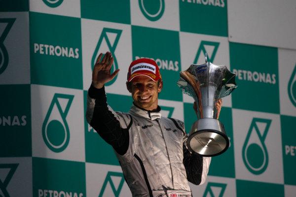 Sepang, Kuala Lumpur, Malaysia 5th April 2009 Jenson Button, Brawn GP BGP001 Mercedes, 1st position, celebrates on the podium. Portrait. Podium.  World Copyright: Andrew Ferraro/LAT Photographic ref: Digital Image _H0Y1390