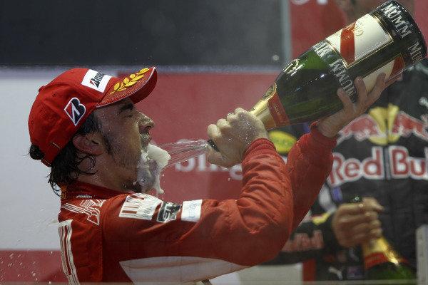 Marina Bay Circuit, Singapore. 26th September 2010. Fernando Alonso, Ferrari F10, 1st position, sprays the victory Champagne. Portrait. Podium.  World Copyright: Andrew Ferraro/LAT Photographic ref: Digital Image _Q0C6271
