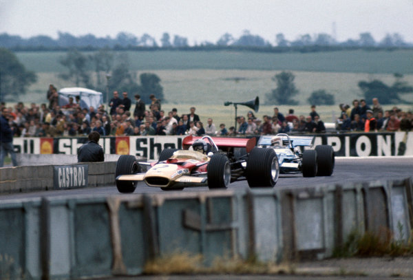 Silverstone, Great Britain. 19th July 1969.Jochen Rindt, (Lotus 49B-Ford), 4th position, leads Jackie Stewart (Matra MS80-Ford), 1st position, action.World Copyright: LAT Photographic.Ref: Colour Transparency.