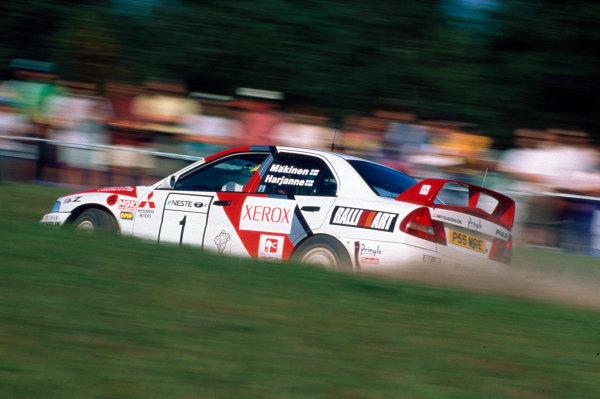 Finnish Rally, Finland. 29-31 August 1997.Tommi Makinen/Seppo Harjanne (Mitsubishi Lancer Evo4), 1st position, action.World Copyright: LAT PhotographicRef: 35mm transparency.
