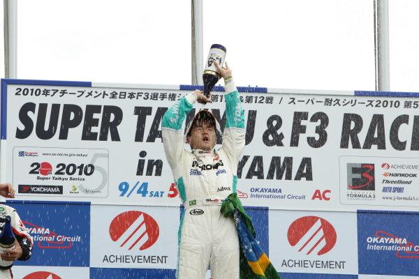 2010 Japanese Formula Three ChampionshipOkayama, Japan. 4th September 2010.Rd 12 Winner Rafael Suzuki ( #36 PETRONAS TEAM TOM'S ) podium.World Copyright: Yasushi Ishihara/LAT Photographicref: 2010JF3_R12_005