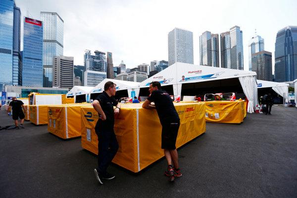 2016/2017 FIA Formula E Championship. Hong Kong ePrix, Hong Kong, China. Thursday 6 October 2016. Team members chat in the pit lane. Photo: Zak Mauger/LAT/Formula E ref: Digital Image _X0W1154