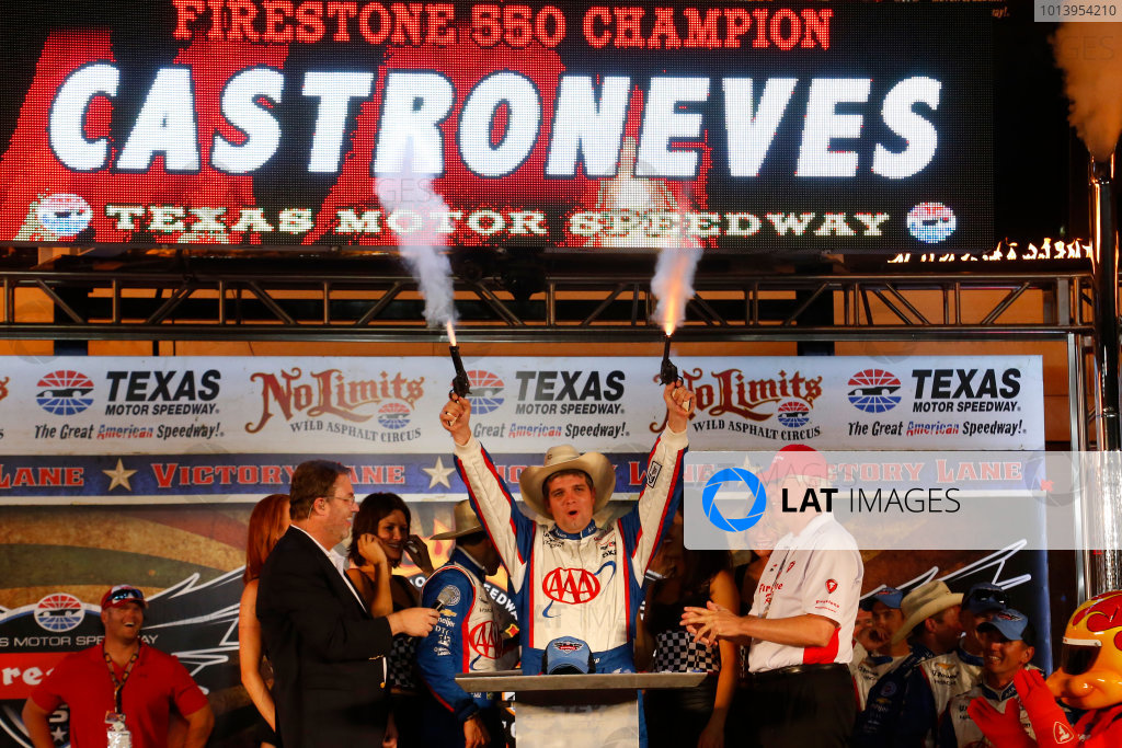 7-8 June, 2013, Fort Worth, Texas USA Helio Castroneves' engineer Jonathan Diuguid shoots the pistols in victory lane ©2013, Lesley Ann Miller LAT Photo USA
