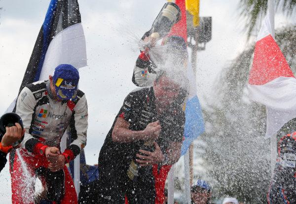 Ott Tanak and Martin Jarveoja soak Toyota team boss Tommi Makinen in champagne on Rally Argentina