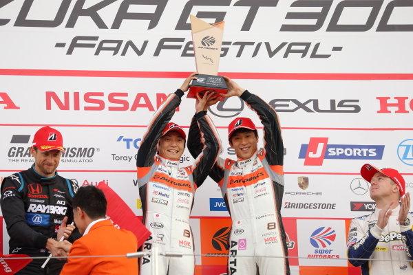 Tomoki Nojiri & Takuya Izawa ( #8  ARTA Honda NSX-GT), 1st in the GT500 class, celebrate on the podium.