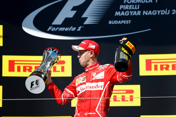Hungaroring, Budapest, Hungary.  Sunday 30 July 2017. Sebastian Vettel, Ferrari, 1st Position, with his trophy. World Copyright: Glenn Dunbar/LAT Images  ref: Digital Image _X4I2905