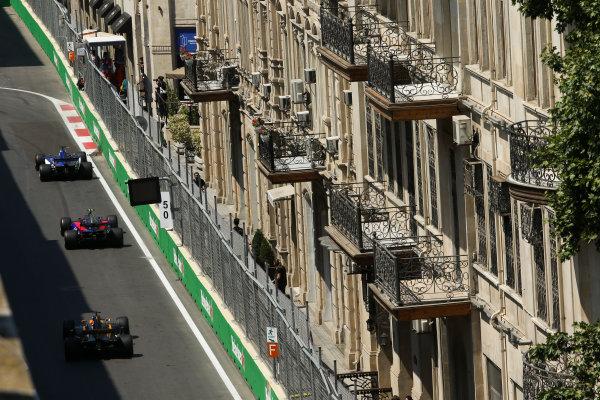 Baku City Circuit, Baku, Azerbaijan. Friday 23 June 2017. Marcus Ericsson, Sauber C36 Ferrari, leads Carlos Sainz Jr, Toro Rosso STR12 Renault, and Nico Hulkenberg, Renault R.S.17. World Copyright: Charles Coates/LAT Images ref: Digital Image AX0W5495