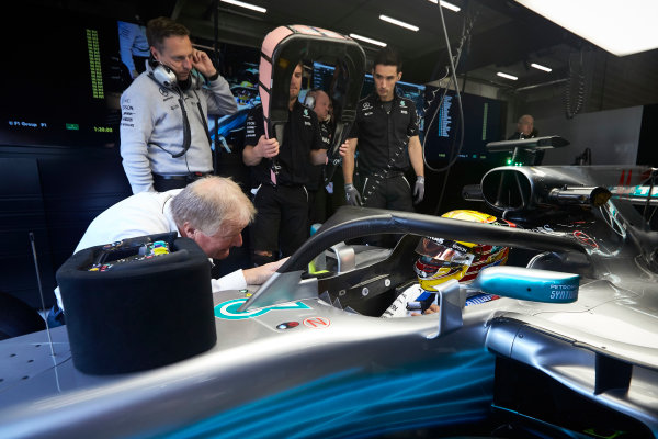 Spa Francorchamps, Belgium.  Friday 25 August 2017. Lewis Hamilton, Mercedes AMG, climbs into his car with the Halo device fitted. World Copyright: Steve Etherington/LAT Images  ref: Digital Image SNE10898
