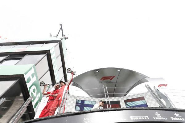 Sebastian Vettel, Ferrari, 1st position, leaves the podium with his trophy.