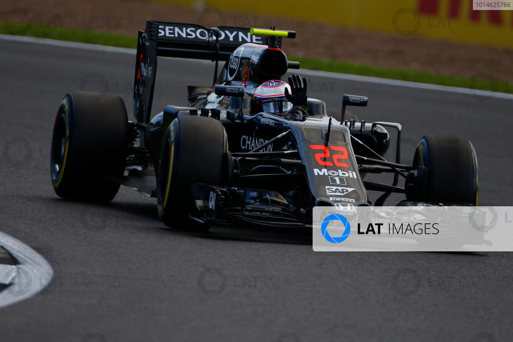Silverstone, Northamptonshire, UK Friday 8 July 2016. Jenson Button, McLaren MP4-31 Honda, gives the fans a wave from his cockpit. World Copyright: Hone/LAT Photographic ref: Digital Image _ONY8044