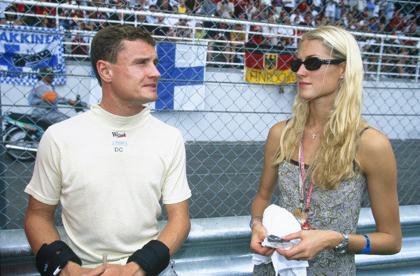 Sepang, Kuala Lumpur, Malaysia. 15-17 October 1999. David Coulthard (McLaren Mercedes) and girlfriend Heidi. Portrait. Ref: 99MAL65. World Copyright - LAT Photographic