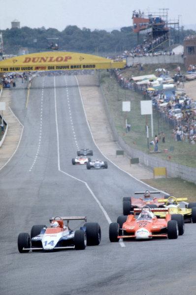 Kyalami, South Africa. 28 February-1 March 1980. Clay Regazzoni (Ensign N180-Ford Cosworth) leads Patrick Depailler (Alfa Romeo 179B), Keke Rosberg (Fittipaldi F7-Ford Cosworth) and Gilles Villeneuve (Ferrari 312T5). World Copyright: LAT Photographic. Ref: 80SA25