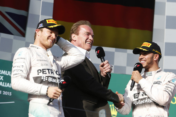Albert Park, Melbourne, Australia. Sunday 15 March 2015. Nico Rosberg, Mercedes AMG, 2nd Position, and Lewis Hamilton, Mercedes AMG, 1st Position, are interviewed on the podium by Actor Arnold Schwarzenegger. World Copyright: Charles Coates/LAT Photographic. ref: Digital Image _N7T1480