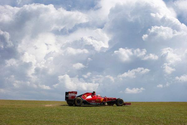 Interlagos, Sao Paulo, Brazil. Friday 7 November 2014. Kimi Raikkonen, Ferrari F14T, runs across the grass. World Copyright: Steven Tee/LAT Photographic. ref: Digital Image _L4R0990