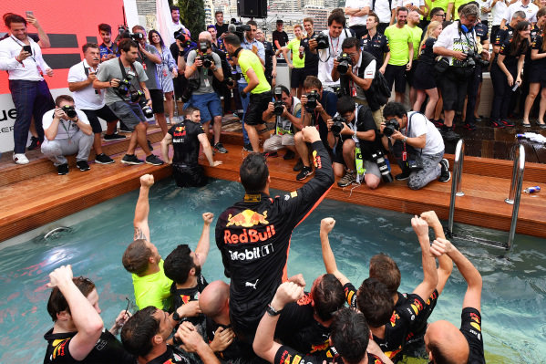 Race winner Daniel Ricciardo (AUS) Red Bull Racing celebrates with the team in the Red Bull Energy Station swimming pool