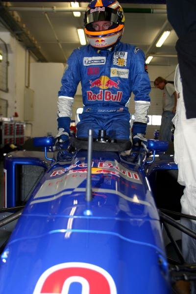 Colin Fleming (USA) gets into an F3000 car.
