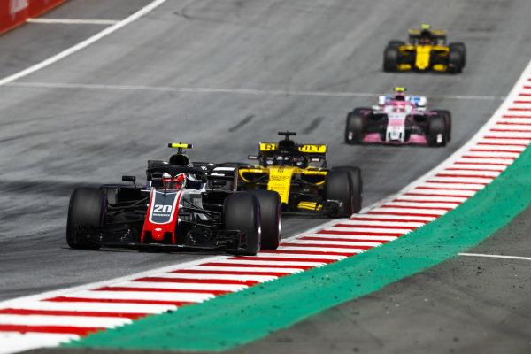 Kevin Magnussen, Haas F1 Team VF-18 Ferrari,leads Nico Hulkenberg, Renault Sport F1 Team R.S. 18, Esteban Ocon, Force India VJM11 Mercedes, and Carlos Sainz Jr., Renault Sport F1 Team R.S. 18.
