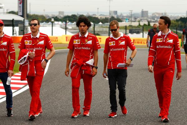 Suzuka Circuit, Japan. Thursday 05 October 2017. Sebastian Vettel, Ferrari, walks the track with his team. World Copyright: Andy Hone/LAT Images  ref: Digital Image _ONZ0672