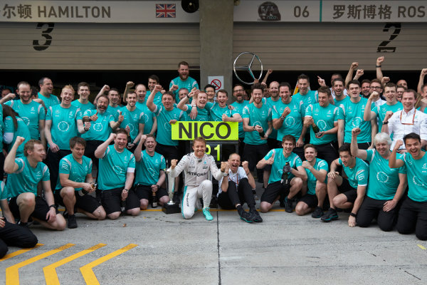 Shanghai International Circuit, Shanghai, China. Sunday 17 April 2016. Nico Rosberg, Mercedes AMG, 1st Position, Tony Ross, Race Engineer, Mercedes AMG, and the Mercedes team celebrate victory after the race. World Copyright: Steve Etherington/LAT Photographic ref: Digital Image SNE12646