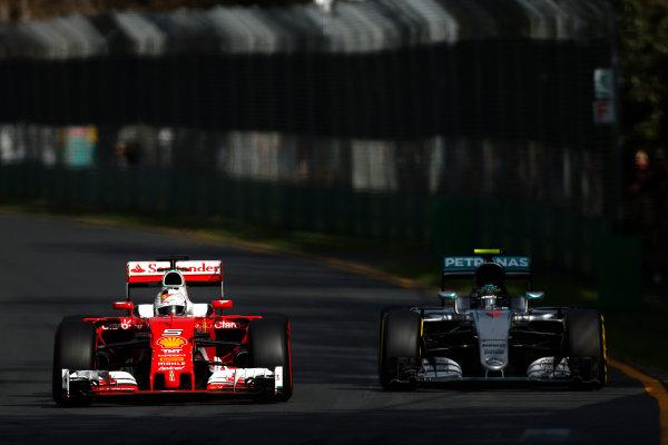 Albert Park, Melbourne, Australia. Sunday 20 March 2016. Sebastian Vettel, Ferrari SF16-H, leads Nico Rosberg, Mercedes F1 W07 Hybrid. World Copyright: Sam Bloxham/LAT Photographic ref: Digital Image _R6T3483