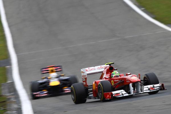 Nurburgring, Germany.24th July 2011Felipe Massa, Ferrari 150° Italia, 5th position, leads Sebastian Vettel, Red Bull Racing RB7 Renault, 4th position. Action. World Copyright: Andy Hone/LAT Photographicref: Digital Image CSP13238