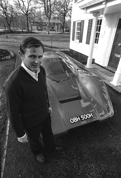 Bruce Mclaren(NZL) with the Mclaren M6GT road car outside his house in Surrey, England, early in 1970