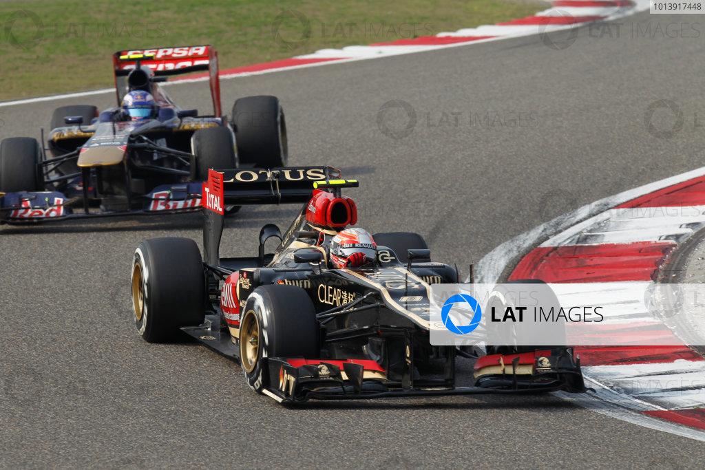 Shanghai International Circuit, Shanghai, China Sunday 14th April 2013 Romain Grosjean, Lotus E21 Renault, leads Daniel Ricciardo, Toro Rosso STR8 Ferrari.  World Copyright: Alastair Staley/LAT Photographic ref: Digital Image _A8C9212