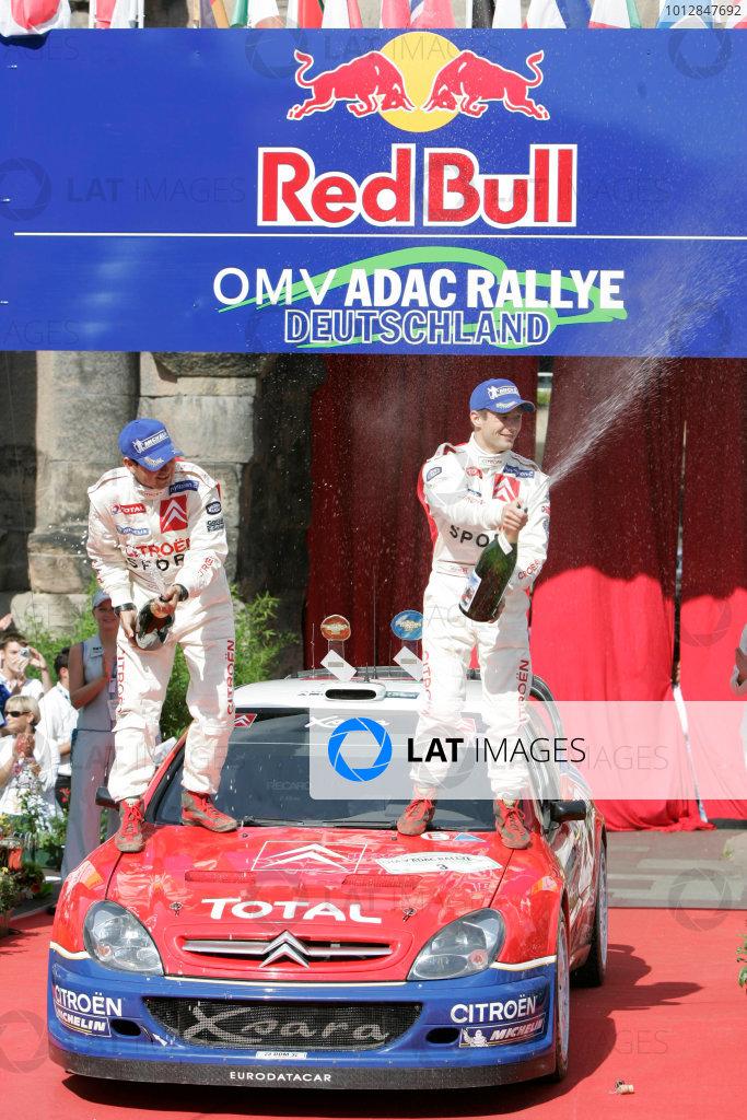 2004 FIA World Rally Champs. Round ten, OMV Deutschland Rally.19th - 22nd August 2004.Sebastien Loeb, Citroen, podium.World Copyright: McKlein/LAT