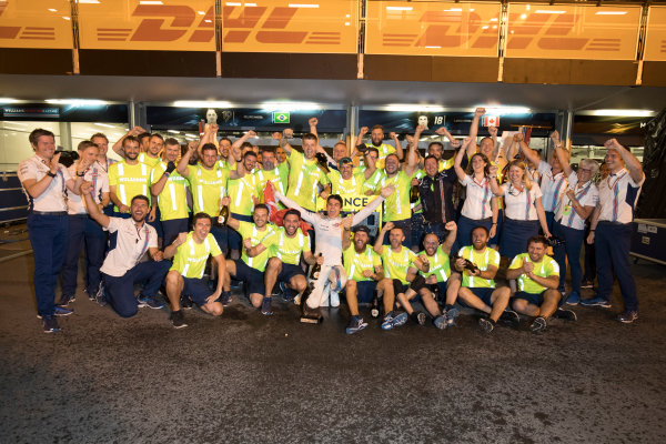 Baku City Circuit, Baku, Azerbaijan. Sunday 25 June 2017. Lance Stroll, Williams Martini Racing, 3rd Position, celebrates with his team. World Copyright: Glenn Dunbar/LAT Images ref: Digital Image _31I4038