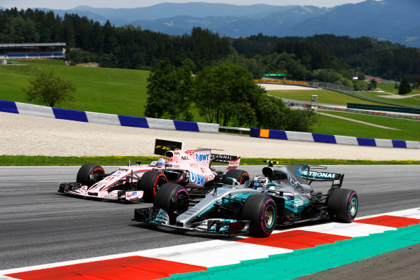 Red Bull Ring, Spielberg, Austria. Sunday 09 July 2017. Valtteri Bottas, Mercedes F1 W08 EQ Power+, races alongside Sergio Perez, Force India VJM10 Mercedes. World Copyright: Steven Tee/LAT Images ref: Digital Image _R3I7942