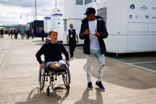 Silverstone, Northamptonshire, UK.  Friday 14 July 2017. Lewis Hamilton, Mercedes AMG, talks to recovering British Formula 4 driver Billy Monger in the paddock. World Copyright: Andy Hone/LAT Images  ref: Digital Image _ONY6357