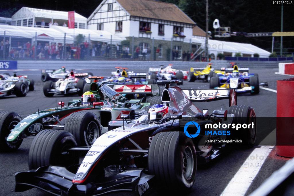 Kimi Räikkönen, McLaren MP4-19B Mercedes leads Mark Webber, Jaguar R5 Cosworth.