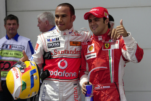 Pole sitter Felipe Massa and 2nd placed Lewis Hamilton give a thumbs up to the media in parc fermé.