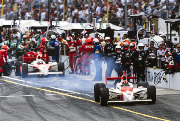 Hélio Castroneves, Penske Racing, Dallara IR-03 Toyota, leads Gil de Ferran, Penske Racing, G-Force GF05 Toyota, in the pit lane.