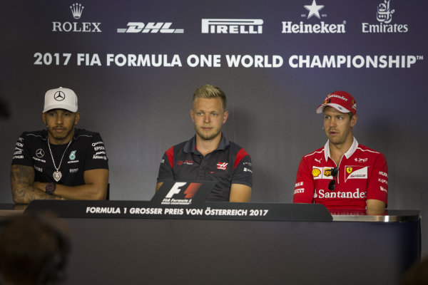 Lewis Hamilton (GBR) Mercedes AMG F1, Kevin Magnussen (DEN) Haas F1 and Sebastian Vettel (GER) Ferrari in the Press Conference at Formula One World Championship, Rd9, Austrian Grand Prix, Preparations, Spielberg, Austria, Thursday 6 July 2017.