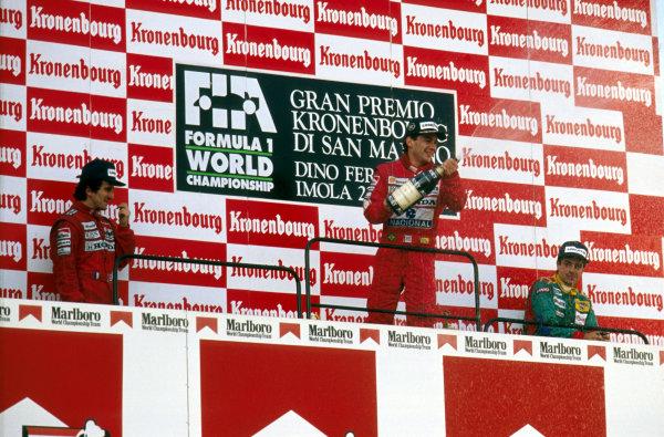 Imola, Italy.21-23 April 1989.Ayrton Senna (McLaren Honda) 1st position, Alain Prost (McLaren Honda) 2nd position and Alessandro Nannini (Benetton B188 Ford) 3rd position celebrate on the podium.Ref-89 SM 03.World Copyright - LAT Photographic