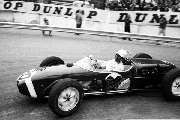 Race winner Stirling Moss (GBR) Lotus 18. Formula One World Championship, Rd1, Monaco Grand Prix, Monte Carlo, Monaco, 14 May 1961.