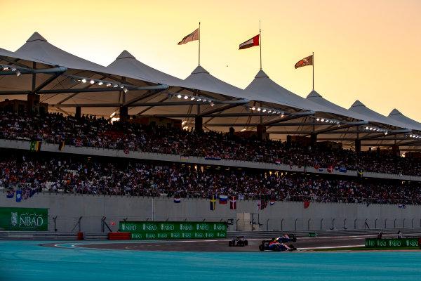 Yas Marina Circuit, Abu Dhabi, United Arab Emirates. Sunday 27 November 2016. Esteban Ocon, Manor MRT05 Mercedes, leads Carlos Sainz Jr, Toro Rosso STR11 Ferrari, and Pascal Wehrlein, Manor MRT 05 Mercedes. World Copyright: Zak Mauger/LAT Photographic ref: Digital Image _X0W9260