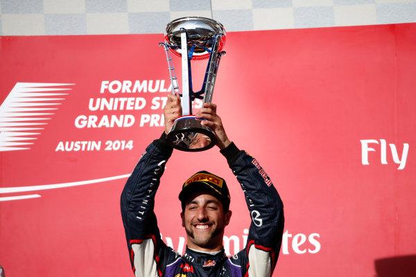 Circuit of the Americas, Austin, Texas, United States of America. Sunday 2 November 2014. Daniel Ricciardo, Red Bull Racing, 3rd Position, lifts his trophy. World Copyright: Glenn Dunbar/LAT Photographic. ref: Digital Image _W2Q8654