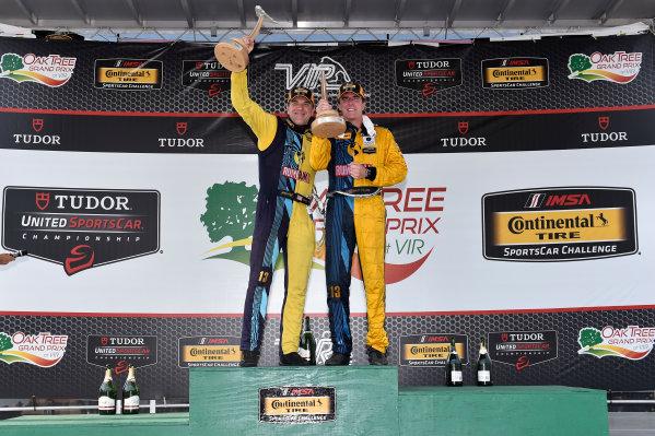 21-22 August 2015, Alton, Virginia USA 13, Porsche, 911, GS, Matt Plumb, Hugh Plumb celebrate the win on the podium ?2014, Scott R LePage  LAT Photo USA
