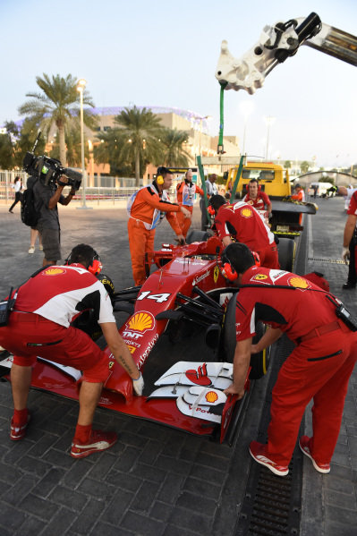 The car of Fernando Alonso (ESP) Ferrari F14 T is recovered after stopping on track in FP2. Formula One World Championship, Rd19, Abu Dhabi Grand Prix, Practice, Yas Marina Circuit, Abu Dhabi, UAE, Friday 21 November 2014.