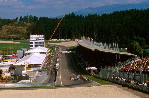 A1-Ring, Zeltweg, Austria.19-21 September 1997.Mika Hakkinen leads the field into the Castrol Kurve at the start.Ref-97 ITA 07.World Copyright - LAT Photographic