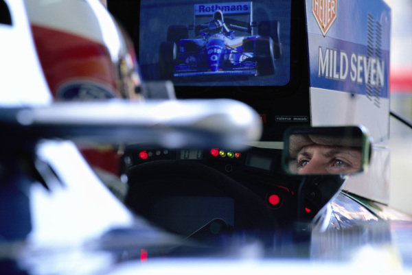 Michael Schumacher watches a monitor showing Damon Hill from the cockpit of his Benetton B194 Ford during the European Grand Prix weekend at Jerez.